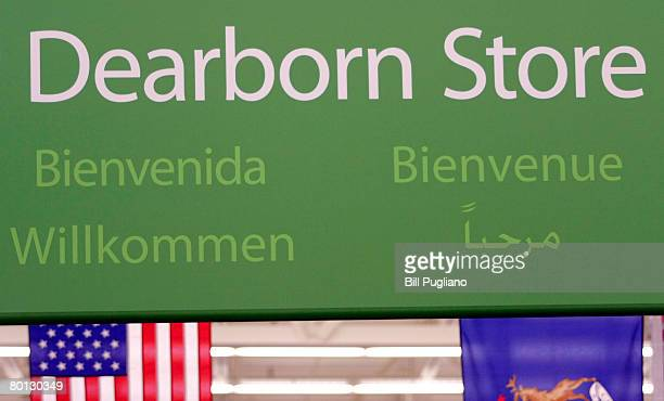 A sign hanging rom the ceiling welcomes visitors in several languages at a new multilingual WalMart that will stock the largest selection of Middle...
