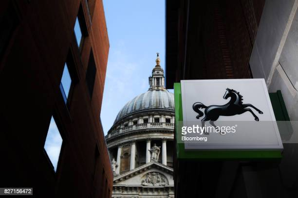A sign hangs above a Lloyds bank branch a unit of Lloyds Banking Group Plc near St Paul's Cathedral in London UK on Friday Aug 4 2017 Lloyds is in...
