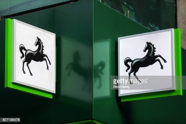 A sign hangs above a Lloyds bank branch a unit of Lloyds Banking Group Plc in London UK on Friday Aug 4 2017 Lloyds is in talks to lease a new London...