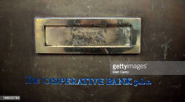 A sign hangs above a mail slot at a branch of the cooperative bank on May 10 2013 in Exeter England The Moody's rating agency has downgraded the Coop...