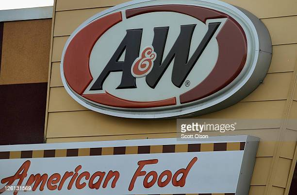 A sign hangs above a Yum Brands AW restaurant on September 22 2011 in Oak Lawn Illinois Yum Brands Inc which owns KFC Pizza Hut and Taco Bell has...