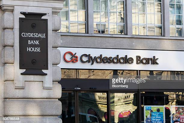 A sign hangs above the entrance to a branch of Clydesdale Bank Plc owned and operated by National Australia Bank Ltd in London UK on Tuesday Jan 19...