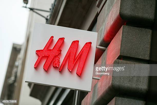 A sign hangs above the entrance to a HM fashion clothing store operated by Hennes and Mauritz AB in London UK on Friday Oct 16 2015 Britain's...