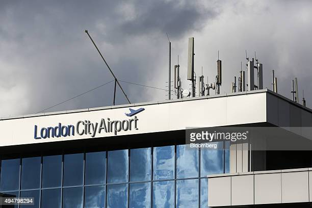 A sign hangs above the entrance to London City Airport in London UK on Wednesday Oct 28 2015 Global Infrastructure Partners LP are looking to...