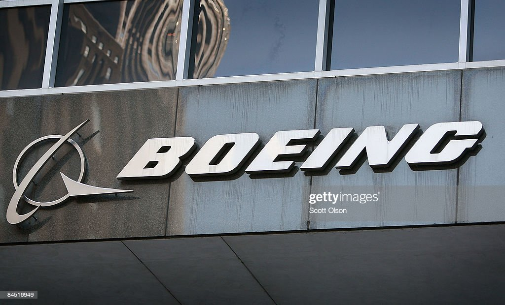 A sign hangs above the entrance to The Boeing Company's headquarters on January 28, 2009 in Chicago, Illinois. Today Boeing reported a fourth-quarter loss, followed by a lower than expected 2009 forecast, and an announcement it would cut 10.000 jobs.