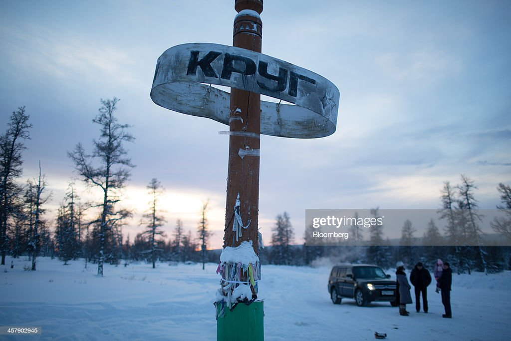 A sign hangs from a post marking the edge of the polar circle in taiga forest outside the mining town of Udachny, Sakha Republic, Russia, on Sunday, Dec. 15, 2013. Russia plans to maintain control of Mirny-based Alrosa, which produces a quarter of the world's diamonds by value and more rough diamonds than De Beers by carat. Photographer: Andrey Rudakov/Bloomberg via Getty Images