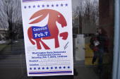 A sign hangs in a window advertising the Democratic presidential caucus February 7 2004 in Seattle Washington Residents of Washington will take in...