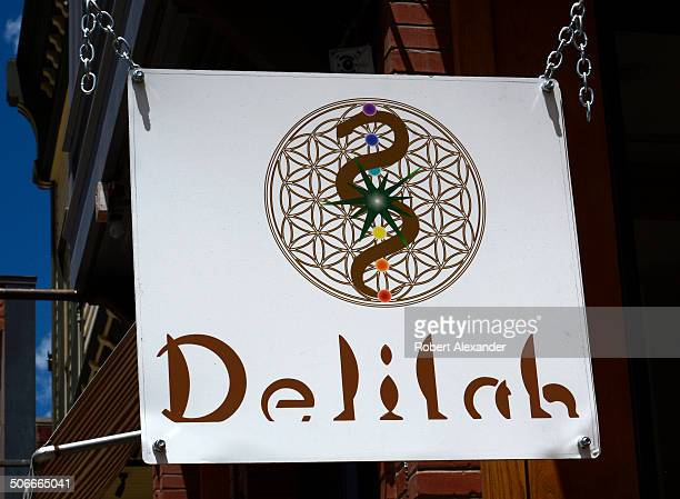 A sign hangs in front of Delilah's one of several medical and recreational marijuana retail stores in Telluride Colorado