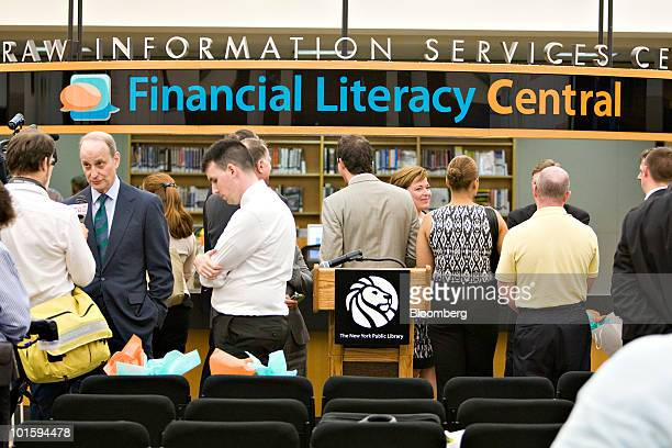 A sign hangs in the 'Financial Literacy Central' at the New York Public Library's Science Industry and Business Library during its official opening...