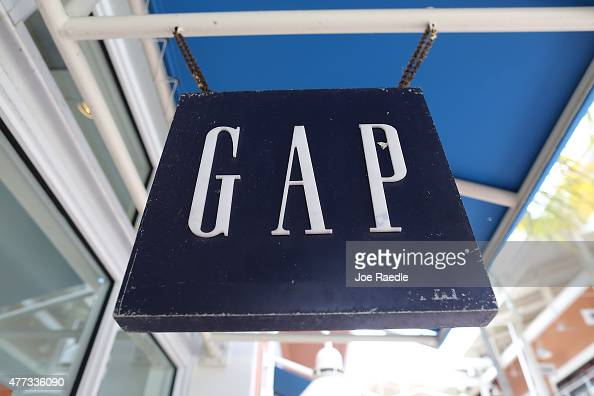 A sign hangs in the front of a GAP store on June 16 2015 in Miami Florida Gap Inc announced that it plans to close 175 of 675 stores in North America...