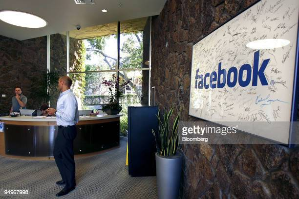 A sign hangs in the lobby of Facebook Inc's headquarters in Palo Alto California US on Tuesday Sept 8 2009 Facebook Inc had 65 million mobile users...
