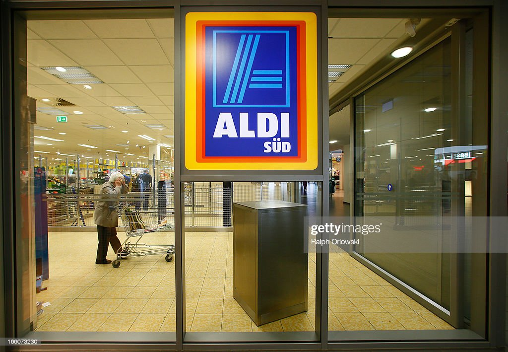 A sign hangs in the window of an Aldi store on April 8, 2013 in Ruesselsheim near Frankfurt, Germany. Aldi, which today is among the world's most successful discount grocery store chains, will soon mark its 100th anniversary and traces its history back to Karl Albrecht, who began selling baked goods in Essen on April 10, 1913 and founded the Aldi name by shortening the phrase Albrecht Discount. His sons Karl Jr. and Theo expanded the chain dramatically, creating 300 stores by 1960 divided between northern and southern Germany, with Aldi Nord and Aldi Sued, respectively. Today the two chains have approximately 4,300 stores nationwide and have also expanded into other countries across Europe and the USA. Aldi Nord operates in the USA under the name Trader Joe's.