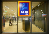 A sign hangs in the window of an Aldi store on April 8 2013 in Ruesselsheim near Frankfurt Germany Aldi which today is among the world's most...