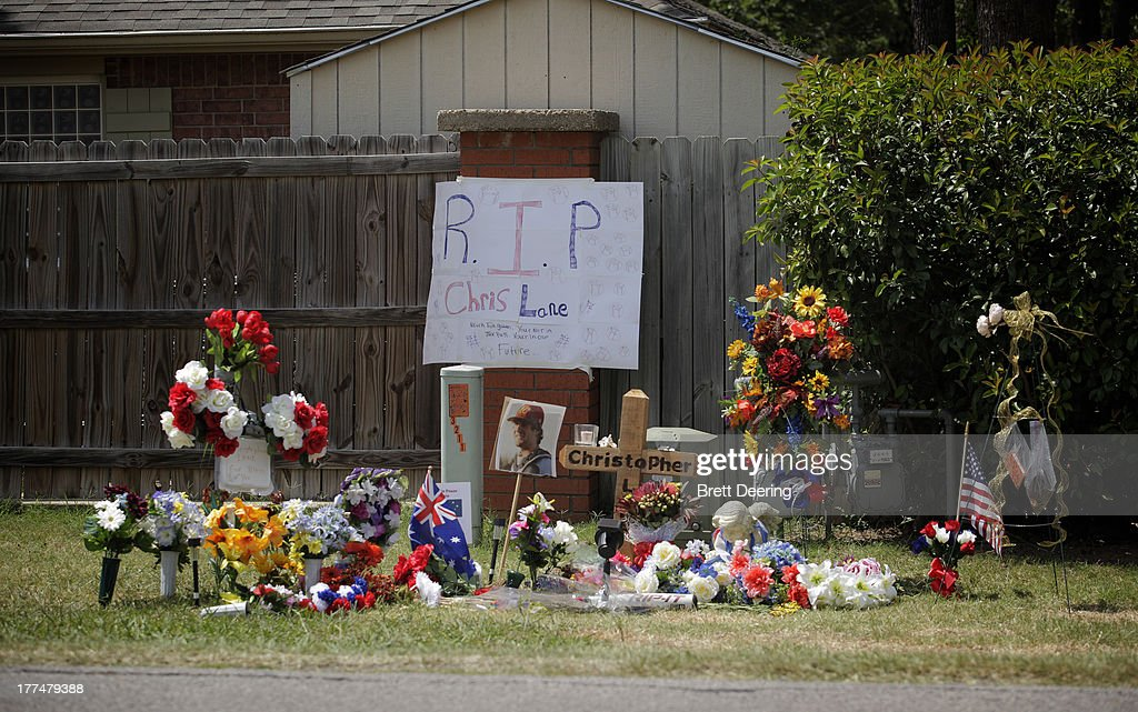 A sign hangs on a makeshift memorial for slain Australian college student Christopher Lane outside the neighborhood where he was killed August 23...