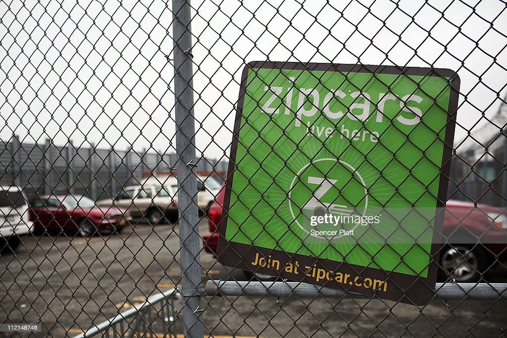 A sign hangs on a parking lot that holds Zipcars on April 13, 2011 in the Brooklyn borough of New York City. Zipcar, a short term car rental company, is set to debut on April 14, on the Nasdaq Stock Market in hopes of raising as much as $133 million under the symbol ZIP.