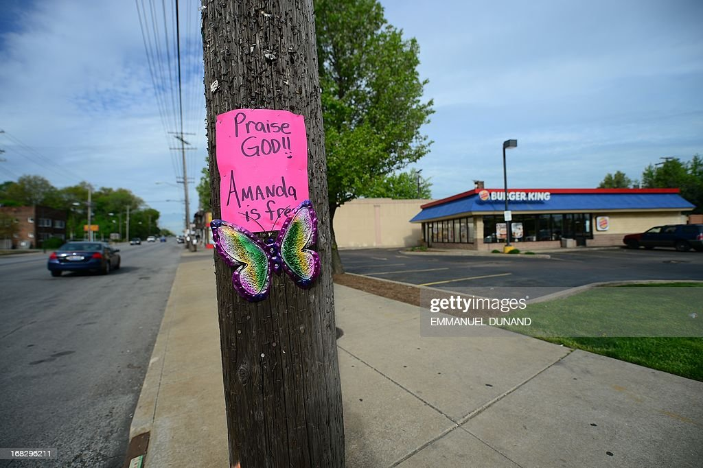 A sign hangs on a street pole near the Burger King restaurant where Amanda Berry was working and last seen a decade ago, after three women were held captive for a decade in a house, May 8, 2013 in Cleveland, Ohio. Three brothers have been arrested in connection with the kidnapping of three women found safe in a home after being missing for a decade, authorities said. There were more questions than answers the day after the stunning turn of events that began with a frantic arm sticking out of a screen door, a woman screaming for help, and a neighbor kicking in the door to free her in a working-class neighborhood of the city in the American heartland. Ariel Castro and his brothers - Pedro, 54, and Onil, 50 have been detained, authorities said. AFP PHOTO/Emmanuel Dunand