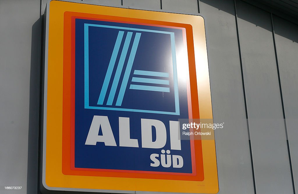 A sign hangs on an Aldi store on April 8, 2013 in Ruesselsheim near Frankfurt, Germany. Aldi, which today is among the world's most successful discount grocery store chains, will soon mark its 100th anniversary and traces its history back to Karl Albrecht, who began selling baked goods in Essen on April 10, 1913 and founded the Aldi name by shortening the phrase Albrecht Discount. His sons Karl Jr. and Theo expanded the chain dramatically, creating 300 stores by 1960 divided between northern and southern Germany, with Aldi Nord and Aldi Sued, respectively. Today the two chains have approximately 4,300 stores nationwide and have also expanded into other countries across Europe and the USA. Aldi Nord operates in the USA under the name Trader Joe's.