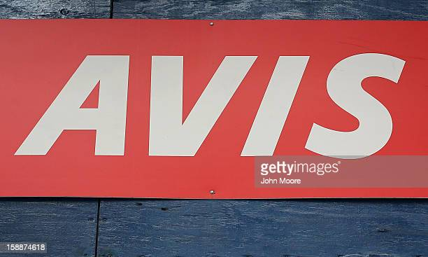 A sign hangs on an Avis rental car branch in Manhattan on January 2 2013 in New York City Avis Budget Group announced January 2 that it has agreed to...