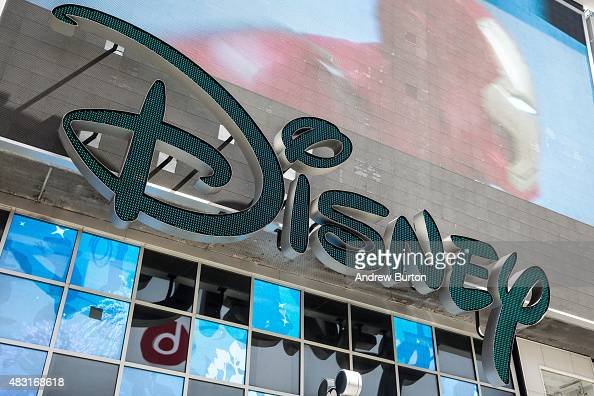 A sign hangs on the Disney store in Times Square on August 6 2015 in New York City Stock prices of media companies including Disney have dropped as...