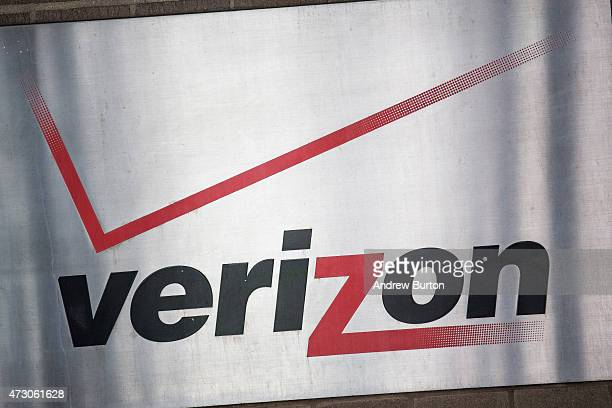 A sign hangs on the Verizon headquarters on May 12 2015 in New York City Verizon announced today that it is buying AOL for $44 billion