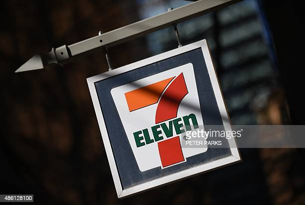 A sign hangs outside a 7Eleven convenience store in Sydney on September 1 2015 The convenience store giant will establish an independent panel to...