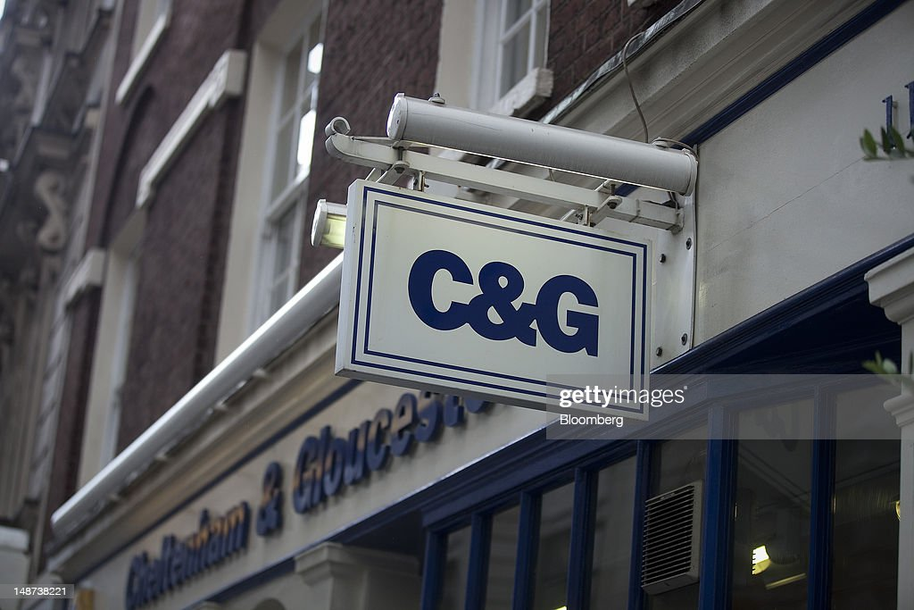 A sign hangs outside a Cheltenham & Gloucester bank branch, part of the Lloyds Banking Group Plc, in London, U.K., on Thursday, July 19, 2012. Lloyds Banking Group Plc agreed to sell 632 branches to Co-Operative Bank Plc for an initial 350 million pounds ($548 million), as the U.K.'s biggest mortgage lender divests assets to comply with its government bailout. Photographer: Simon Dawson/Bloomberg via Getty Images