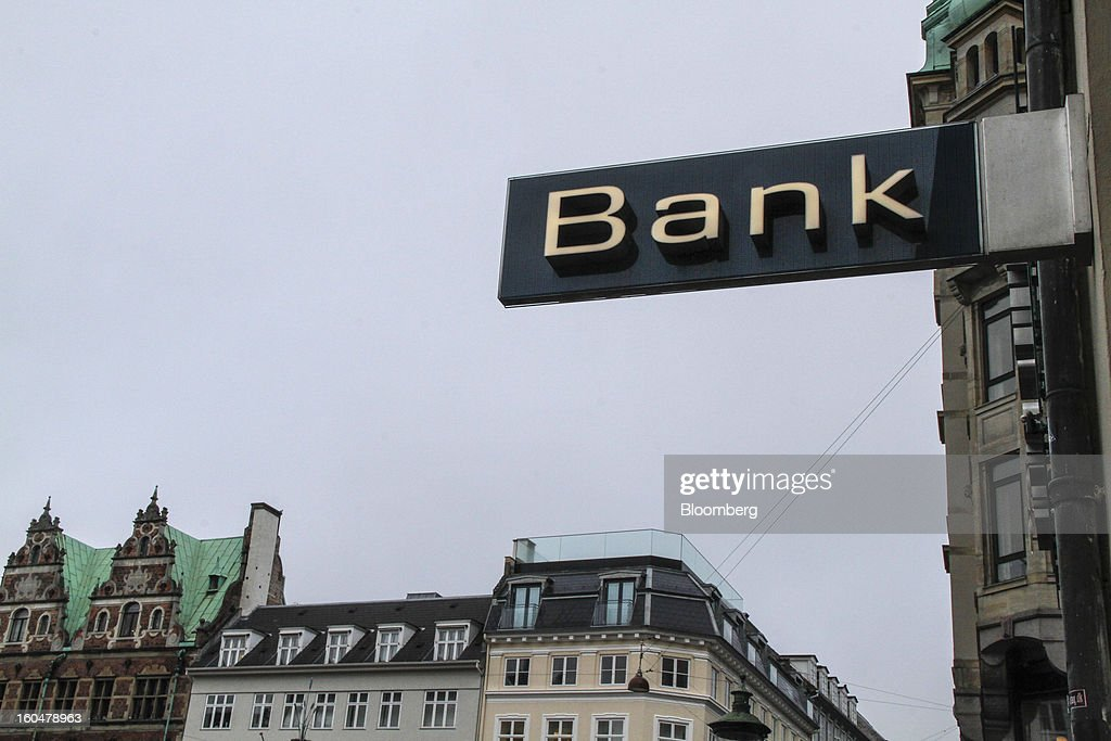 A sign hangs outside a Danske Bank A/S branch near residential housing in Copenhagen, Denmark, on Friday, Feb. 1, 2013. Danish regional banks are struggling to emerge from a burst property bubble that's forced the government resolution agency to take over a dozen lenders after losses on commercial and agricultural loans wiped out capital. Photographer: Freya Ingrid Morales/Bloomberg via Getty Images