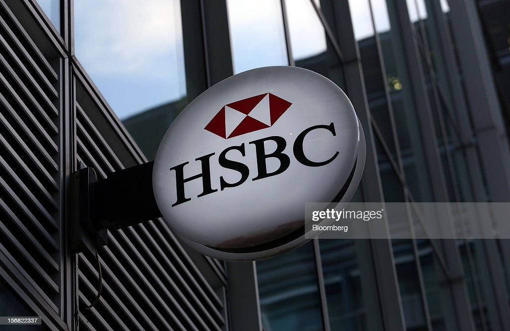 A sign hangs outside a HSBC Holdings Plc bank branch in London, U.K., on Thursday, Nov. 22, 2012. Shares of HSBC have climbed 26 percent this year in London trading, and 30 percent in Hong Kong, as Chief Executive Officer Stuart Gulliver pared costs and sold assets to revive profit and focus on emerging economies in which the bank has a greater market share. Photographer: Chris Ratcliffe/Bloomberg via Getty Images