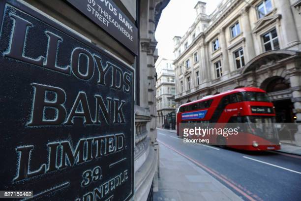A sign hangs outside a Lloyds bank branch a unit of Lloyds Banking Group Plc in London UK on Friday Aug 4 2017 Lloyds is in talks to lease a new...