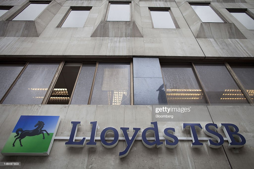 A sign hangs outside a Lloyds TSB bank branch, part of the Lloyds Banking Group Plc, in London, U.K., on Wednesday, July 18, 2012. The U.K. financial regulator said it's investigating seven lenders over attempts to manipulate interbank offered rates as lawmakers criticized it for not opening the probe earlier. Photographer: Simon Dawson/Bloomberg via Getty Images