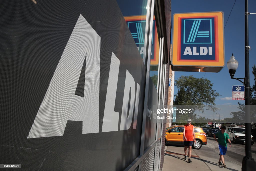 A sign hangs outside an Aldi grocery store on June 12, 2017 in Chicago, Illinois. Aldi has announced plans to open 900 new stores in the United States in the next five years. The $3.4 billion capital investment would create 25,000 jobs and make the grocery chain the third largest in the nation behind Wal-Mart and Kroger.