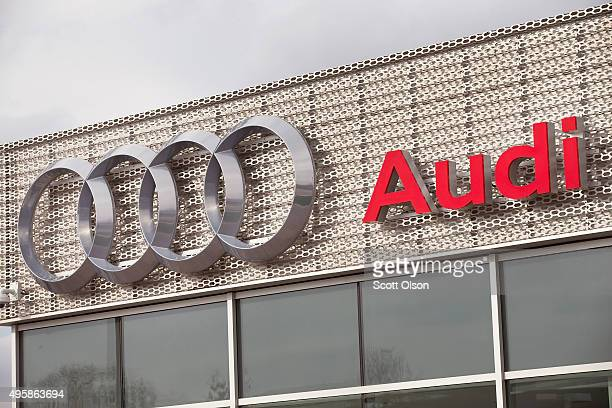 A sign hangs outside an Audi dealership on November 5 2015 in Westmont Illinois Volkswagen which owns Audi and Porsche has directed dealers not to...