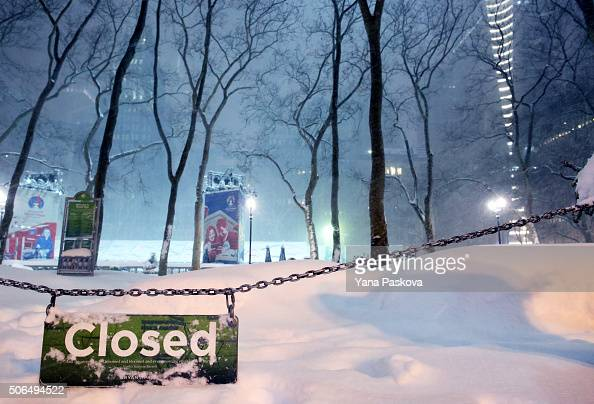 A sign hangs outside Bryant Park as all cars but emergency vehicles are banned from driving on the road on January 23 2016 in New York City The...