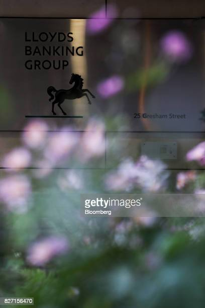 A sign hangs outside the headquarters of Lloyds Banking Group Plc in London UK on Friday Aug 4 2017 Lloyds is in talks to lease a new London office...