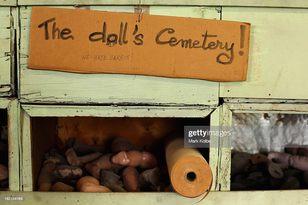 A sign hangs over discarded doll body parts in a waste pile at Sydney's Original Doll Hospital in Bexley on February 19, 2013 in Sydney, Australia. Established in 1913 by Harold Chapman Jnr the Doll hospital is now run by Geoff Chapman, the third generation of Chapmans to run the business and will celebrate 100 years of repairing all types of dolls, teddy bears, rocking horses, umbrellas, prams and various other items.