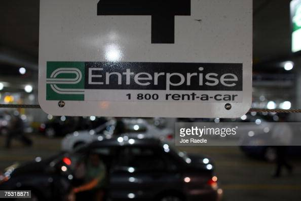 A sign hangs over the Enterprise car rental lot at the Fort Lauderdale/Hollywood International airport July 10 2007 in Fort Lauderdale Florida...