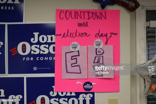 A sign in a campaign office for Democratic candidate Jon Ossoff shows today is E Day indicating that it is Election Day as he runs for Georgia's 6th...