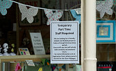 Sign in a shop window in Wells Market Place advertising temporary work over the Christmas period