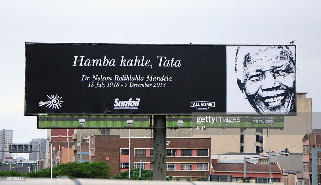 A sign in Durban presents a message in Zulu reading 'Farewell, Father', in honor of late former South African President Nelson Mandela, on the day of Mandela's burial in his hometown of Qunu, on December 15, 2013. Mandela was buried near his homestead Qunu today, ending 10 days of national mourning and global tributes for the prisoner-turned-president who transformed his country and inspired the world. AFP PHOTO / Anesh Debiky
