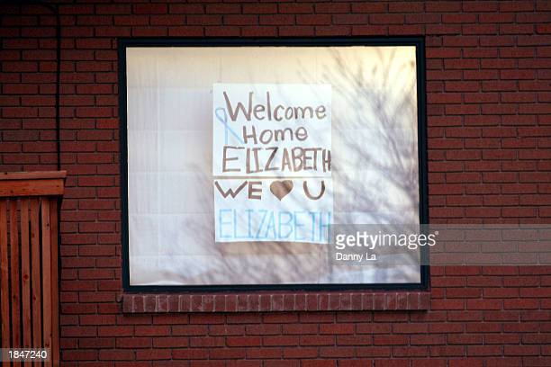 A sign in Elizabeth Smart's neighborhood welcomes her home March 13 2003 in Salt Lake City Utah Elizabeth Smart was abducted nine months ago from her...