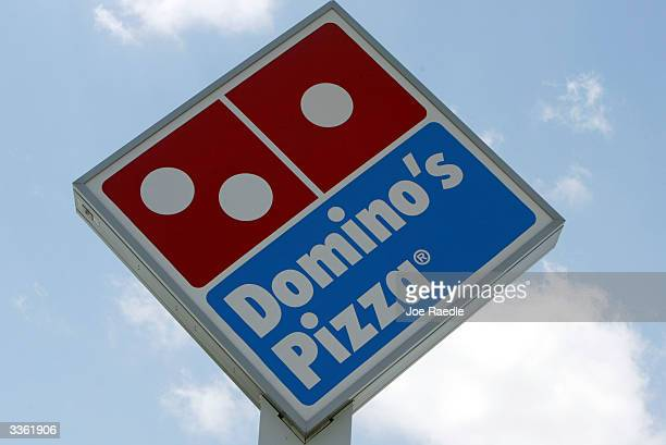 A sign in front of a Domino's Pizza April 14 2004 in Miami Florida Domino's Pizza is looking to raise $300 million in the stock market by listing on...