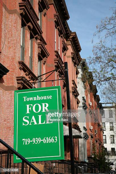 FOR SALE sign in front of a townhouse, Brooklyn, New York, USA