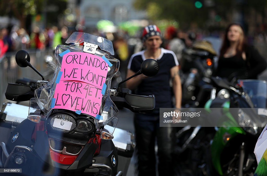 A sign in honor of the victims of the Orlando nightclub shooting is displayed on a motorcycle before the start of the 2016 San Francisco Pride Parade on June 26, 2016 in San Francisco, California. Hundreds of thousands of people came out to watch the annual San Francisco Pride parade, one of the largest in the world.