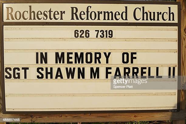 A sign in memory of Army Sgt Shawn Farrell is viewed on the day of his funeral in his home town of Accord on May 8 2014 in Accord New York Sgt...
