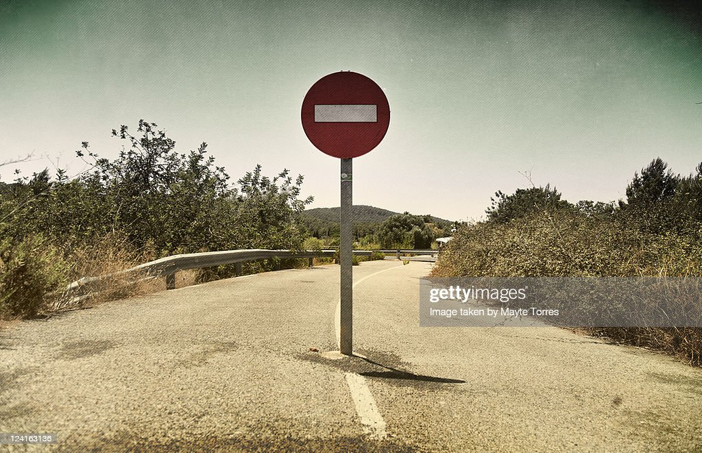 Sign in middle of road : Stock Photo