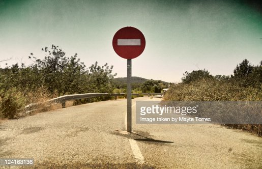 Sign in middle of road