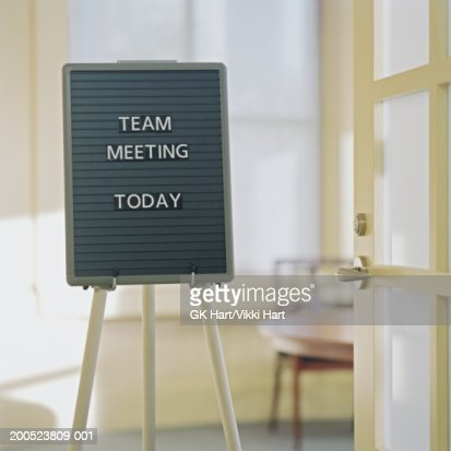 Sign in office reading 'Team Meeting Today'