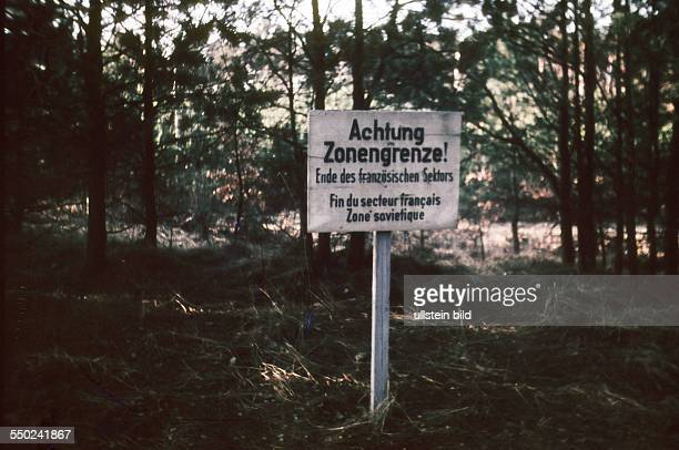 Sign in the Tegel forest in West Berlin near the border to East Germany warning against the leaving of the French sector to the Soviet sector around...
