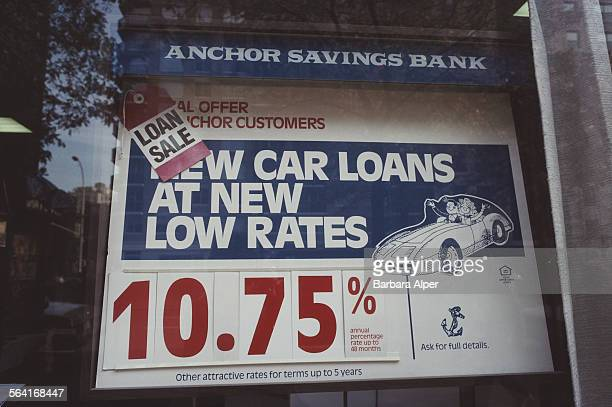 A sign in the window of the Anchor Savings Bank advertising car loan rates New York City USA November 1994