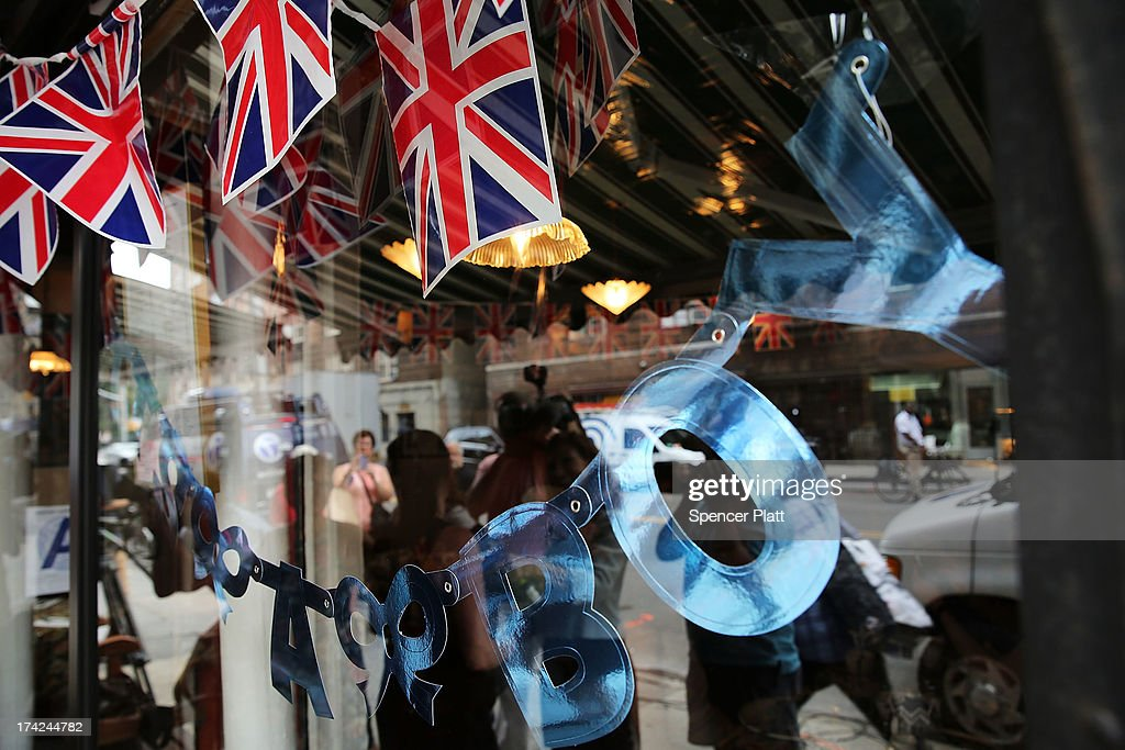A sign in the window of the British restaurant and grocery Tea & Sympathy celebrates Catherine, Duchess of Cambridge, and her husband Prince William's first child on July 22, 2013 in New York City. The Royal couple had a baby boy who was born at 16.24 BST and weighed 8 pounds, 6 ounces. The child, who is now third in line to the throne, has yet to be named.
